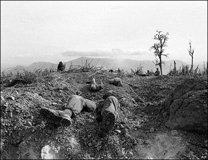 The bodies of U.S. Marines lie half buried on Hill 689, west of Khe Sanh, in 1968. The siege at Khe Sanh was one of the longest and bloodiest battles of the Vietnam War.