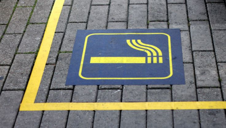 Icons and yellow floor stickers reduces inconsiderate smoking at Copenhagen Airport by 50%