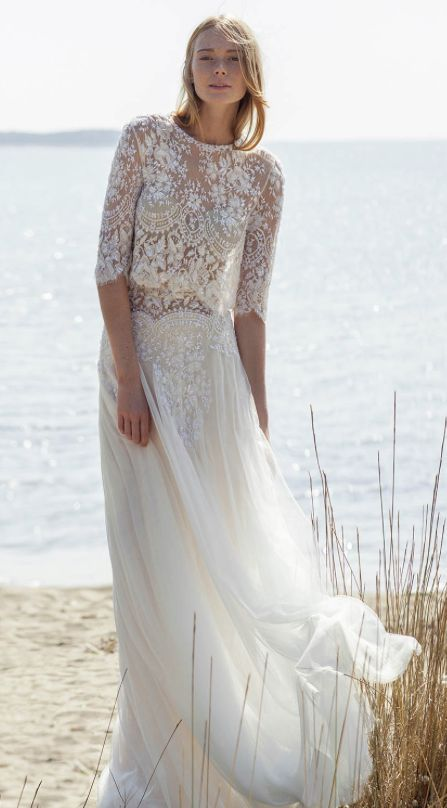Bohemian chic lace top quarter length sleeve wedding dress with flowy tulle skirt; Featured Dress: Christos Costarellos