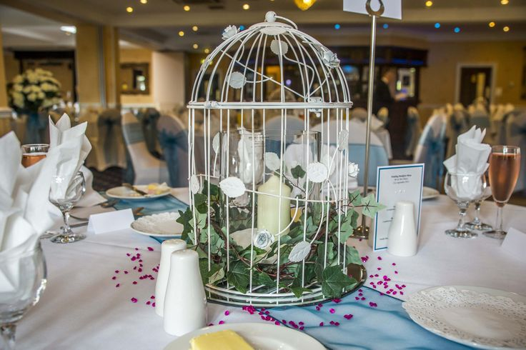 Bird cage with a candle as a centre piece.