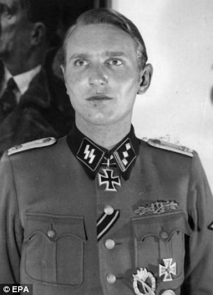 Among those identified is Danish-born SS officer Soren Kam, 91, who is accused of murdering a journalist in 1943