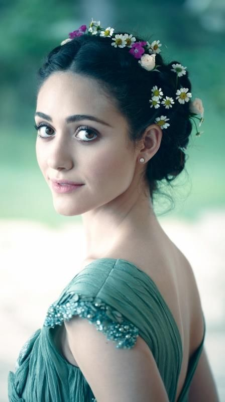 .Emmy Rossum from Shameless. She's a good example of a brown True Winter's eye. Deep and cool usually (not always)