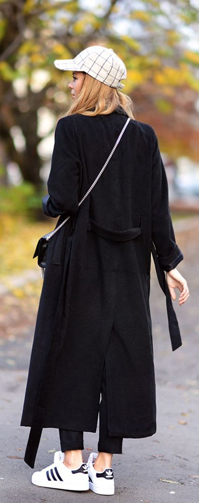 Annette Haga is wearing a black long robe coat from Notion 1.3