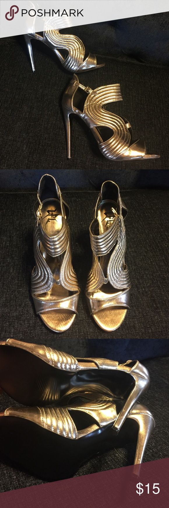 """LFL gold strappy high heels pumps sexy chic glam Great condition, only worn once for New Years last year! Perfect for any sparkly outfit! These shoes are definitely gold, but they could pass for silver with the right outfit. 5"""" heels. True to size LFL Shoes Heels"""