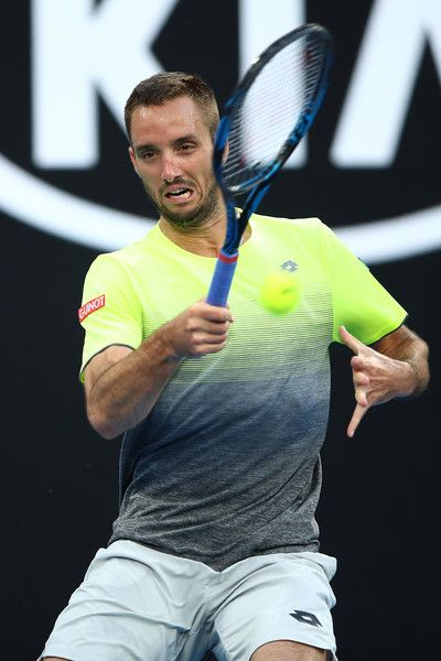 Viktor Troicki Photos - Viktor Troicki of Serbia plays a forehand in his second round match against Nick Kyrgios of Australia on day three of the 2018 Australian Open at Melbourne Park on January 17, 2018 in Melbourne, Australia. - 2018 Australian Open - Day 3