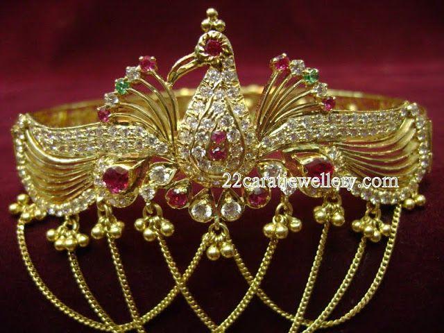 Jewellery Designs: Gold Peacock Vanki (Armlet) Gallery with Gemstones...
