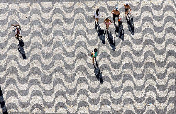 "Roberto Burle Marx's wave pattern of ""pedras portuguesas"" (portuguese stones, the typical black & white patterns found on Brazilian sidewalks) at Copacabana beach, Rio de Janeiro."
