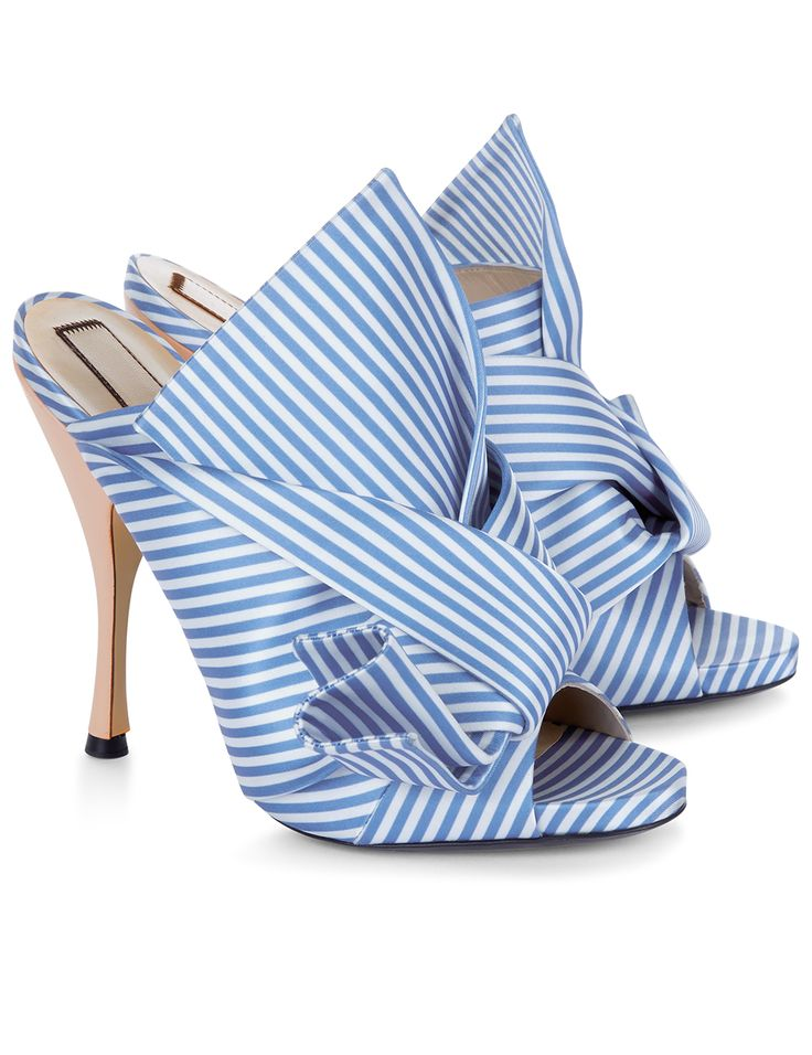 Blue & White Stripe Satin Bow Mules Alessandro Dell'Acqua's fashion line, No.21 showcases rich womenswear pieces with off-kilter footwear to match. Fresh in blue and white candy stripes, these satin mule stilettos are elegantly updated with knotted bows. Slip on with relaxed denim and a ruffled blouse for city chic sensibility.