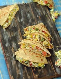 Paneer and corn quesadillas, serve this dinner-time treat to your kids, to see their day end in a fun way! given a choice, your little ones would freak out on corn, but its poor protein quality makes it a not-so-healthy option. However, adding paneer and mozzarella cheese increases the protein quotient of the quesadillas.