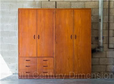 Custom built storage twin set c1965 by Berryman - furniture for life. Constructed from teak panel on oak frame with danish oiled teak veneer front. Features dovetail joints on draws and teak inlay boomerang handles in dark walnut stain