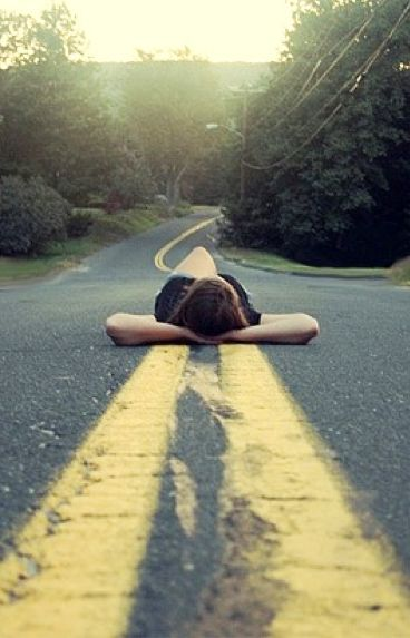I don't get the laying in the middle of the road pictures.  What is the message?  Is she playing chicken?  Is she dead?  Maybe she wants to be dead?  Whatevs.