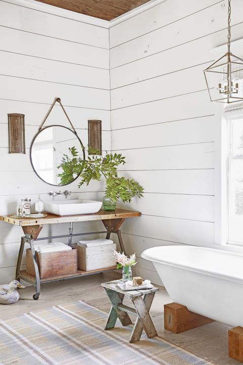 See How a Run-Down Texas Farmhouse Became This Family's Country Dream:  In the (new and improved!) master bath, a claw-foot tub sits on wood blocks. The vanity is simply an old work bench with a new vessel sink, while a simple salvaged doorknob became a smart substitute for a plain old nail.