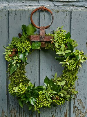 Evergreen  Welcome visitors with a handmade evergreen wreath on the front door. This one by blogger Minna Mercke Schmidt is constructed from moss, ivy, and eucalyptus wired into a frame.   Country Living DIY Wreath Ideas - Holiday Wreath Making Ideas - Country Living