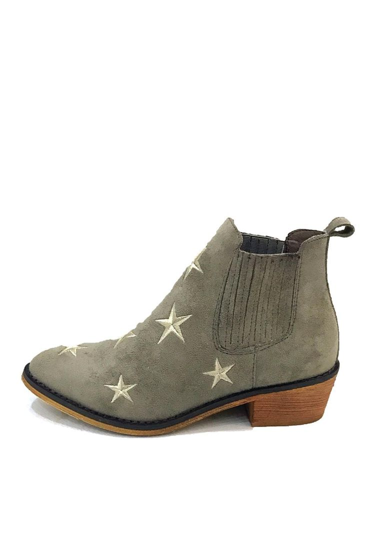 "These cowboy ankle boots with a low stacked heel are so cute! They feature soft faux suede material embroidered star details and a stitched elastic side pieces to make them easy to slip on and off. These boots are perfect with any of your favorite outfits from dresses to sweaters and skinny jeans!  Materials: Faux Suede Heel Height: 1.5"" Fit Tip: These shoes fit true to size Tetsu Star Booties by Mi.im. Shoes - Boots - Flat Boston Massachusetts"