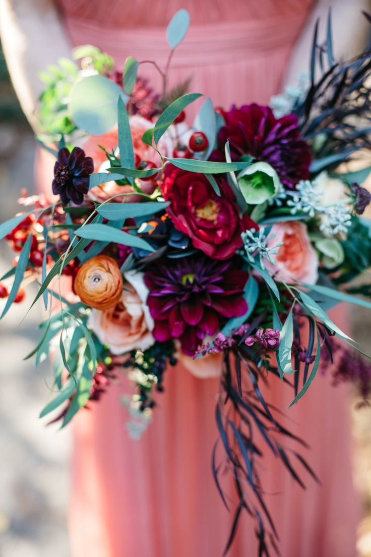 Fall bridesmaid bouquet featuring coral ranunculus, garden roses, burgundy dahlia, smoke bush, eucaulyptus,chocolate cosmos, hanging amaranthus and more. Flowers by Lily + Mint. www.lilyandmint.com. Photo by Studio 13 Designs.