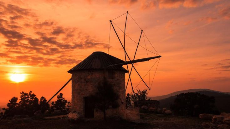 Windmill in a burnning sky by NunoMiguelValente