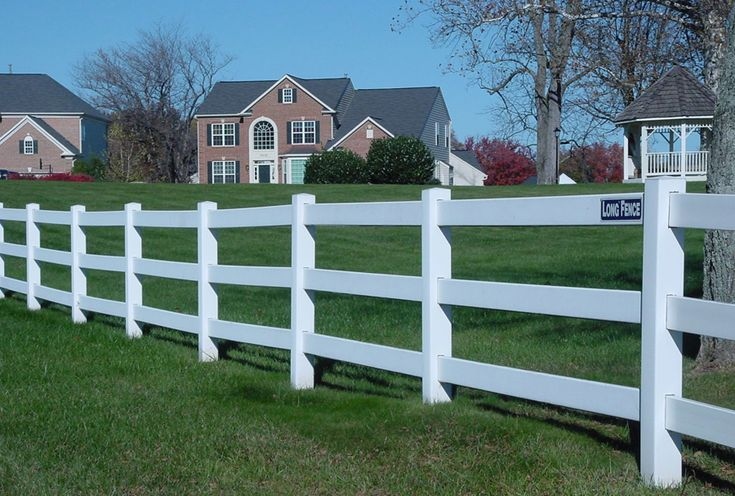 White Vinyl Fencing Around The Horse Pasture Montana
