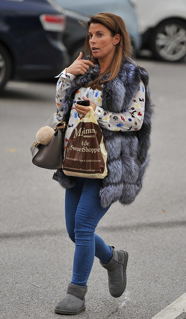 Sweets for her sweets: Coleen Rooney grabbed some treats from Mr Simm's Olde Sweet Shoppe in Alderley Edge, Cheshire on Thursday