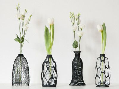 3 D printed vase collection.  Up cycle for plastic bottles. Photo credits : Claudio Morelli