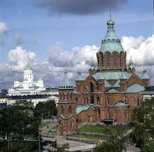 Helsinki, Finland - Uspenski Cathedral (Eastern Orthodox) with the Lutheran Cathedral in the background
