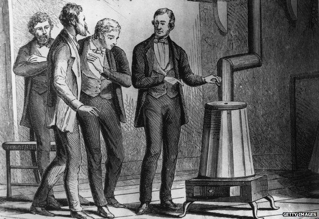 "1839: American inventor Charles Goodyear (1800 - 1860) demonstrating his new dry heat rubber Vulcanization process. Goodyear found that adding sulphur to latex - the goopy sap of the rubber tree - created a much firmer, more durable material, which he used to produce the first tyres and inner tubes. The process was dubbed ""vulcanisation"" after Vulcan, the Roman god of fire (and volcanoes), and is still used to make rubber today."