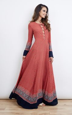 Red navy border print lace up maxi dress. Features long sleeves, lace up detail at the chest with flared semi-sheer maxi length skirt. As seen on Kate Middleton.