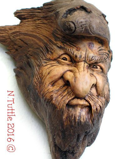 Original wood spirit carving anger mad mean natural rage
