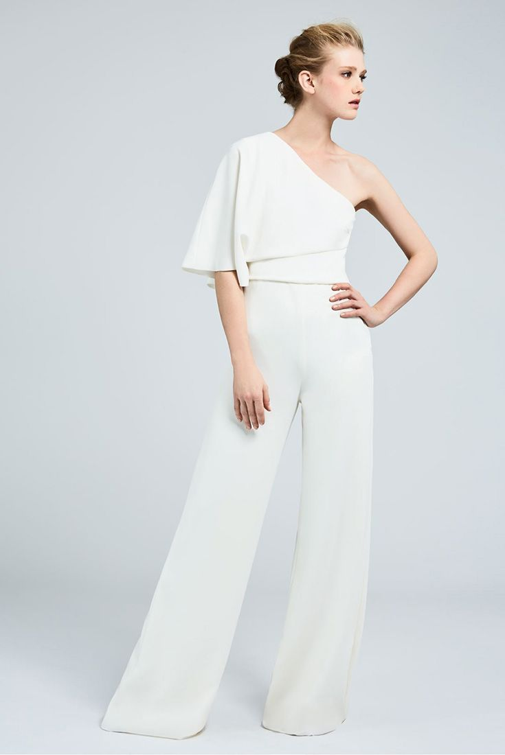 EUGENIA, one-shouldered jumpsuit in milk-white coloured cady, with a full, asymmetrical drape. The trousers sit closely on the hips, becoming free flowing at the bottom. #MaxMaraBridal #weddingdress #abitodasposa
