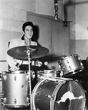 Elvis playing DJ Fontana's drum set