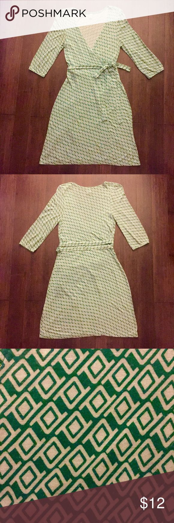 "Green & White Pattern 3/4-Sleeve Wrap Dress Old Navy Green and White Patterned 3/4-Sleeve Wrap Dress  Hits a little below the knee for me. 37.5"" top to bottom, 17"" sleeves, 14"" armpit to armpit, 22"" across the bottom. 100% rayon.   👍Reasonable offers welcome!😄 💐20% off bundles but can increase with the more you bundle!💐 🚫No returns or trades please!😝 🚭Smoke- & pet-free home🐶 Old Navy Dresses"