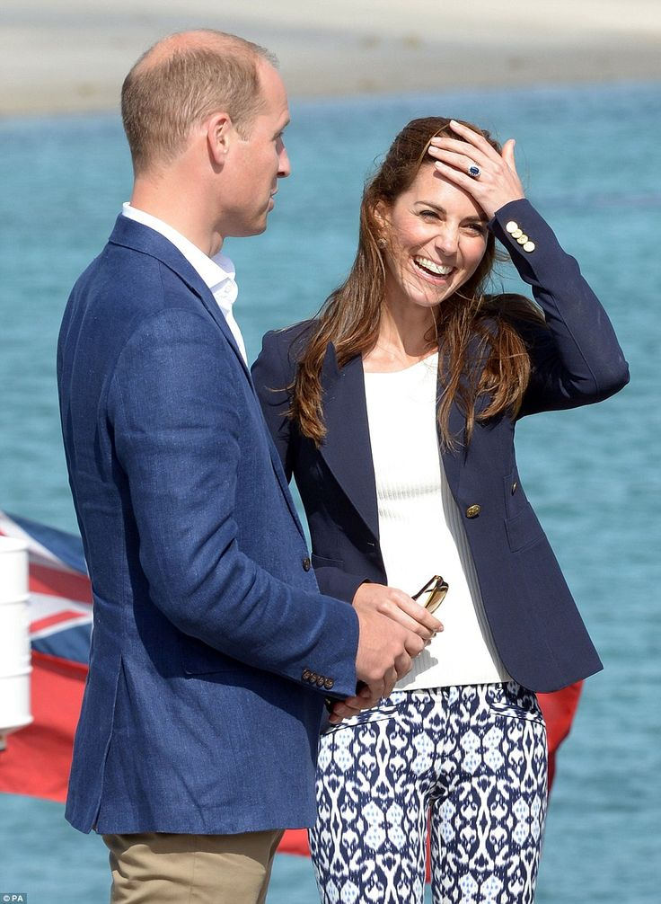 Kate flashes her sapphire and diamond engagement ring, which belonged to William's mother ...