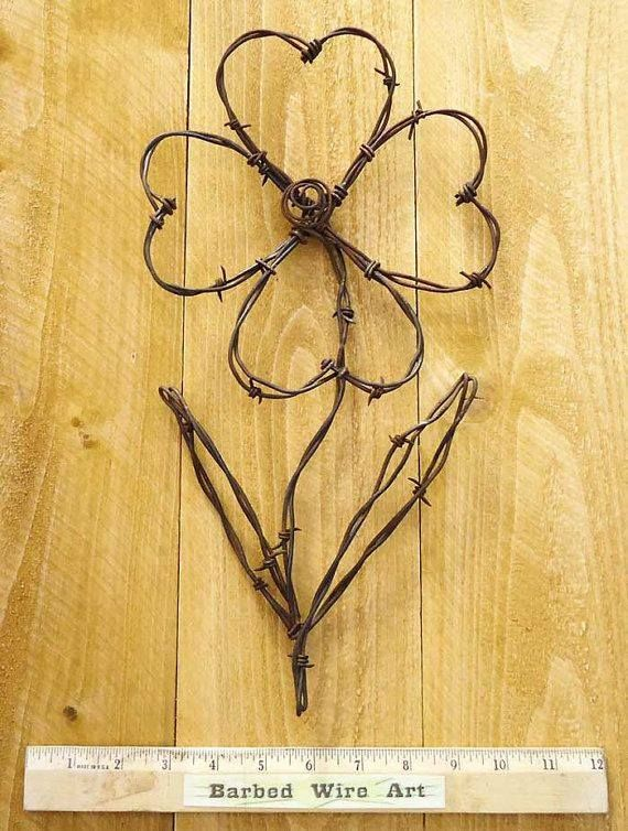 Hand made rustic barbed wire art sculpture. No longer available on Etsy but really pretty idea.