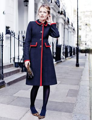 navy blue high-waisted coat with thick red piping