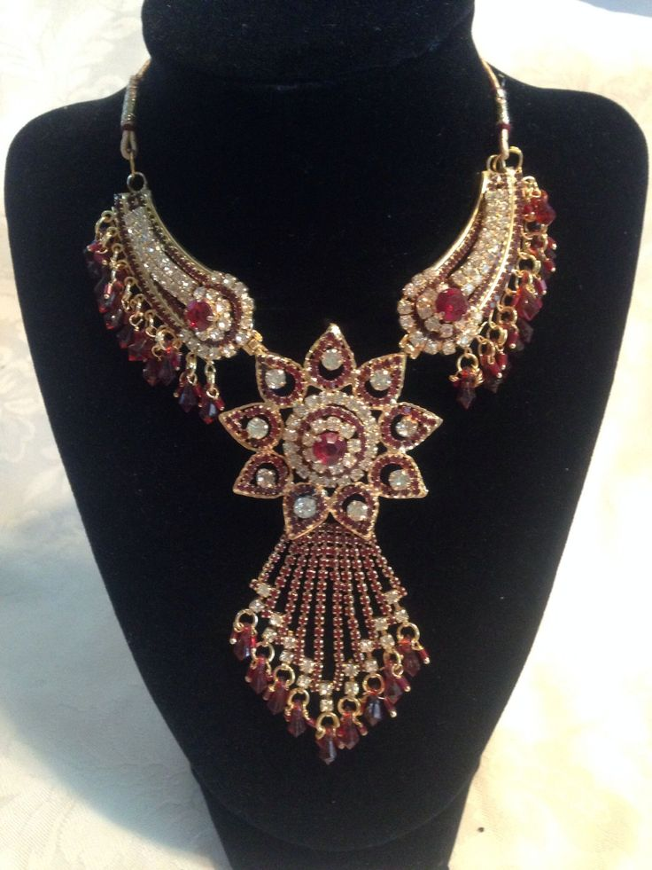 This necklace is beautiful stone work necklace with white american stones combined with red stones and gold finish. - Add glamour to your life with this red stone studded necklace.It is embellished wi