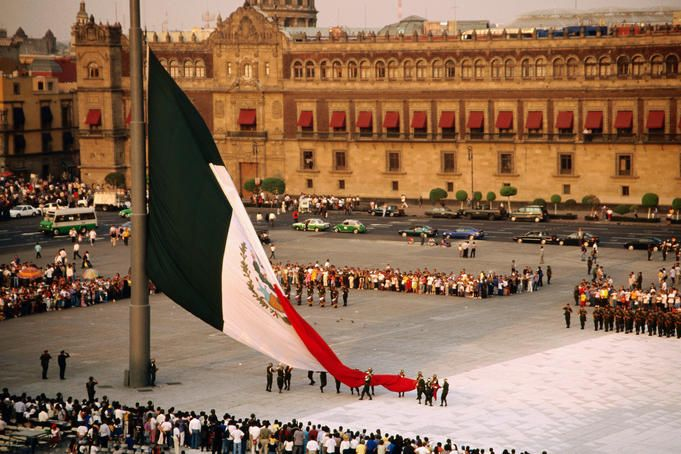 Overhead of ceremonial lowering of Mexican flag in the Zócalo (main city square), Mexico City