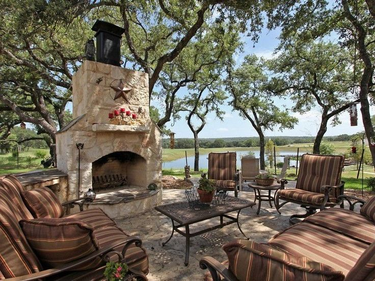 Eclectic Patio with exterior stone floors, stone fireplace, O.w. lee ashbury sofa, outdoor pizza oven, Coffee table