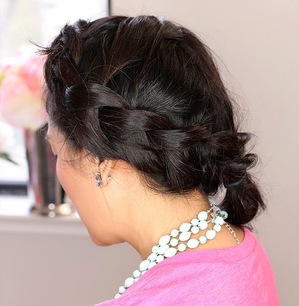 A messy reverse French braid.   Start by prepping roots with a dry hairspray, then spray a texturizing spray from mid-shaft to the ends.  Part hair and do a reverse French braid (like a regular French braid, but instead of pulling the hair over to create the braid, you pull it under) on one side; secure with an elastic ponytail holder.  Repeat on the other side.   Gently remove the elastic from the first braid, and use it to secure both braids where they meet.  Finish with a strong…