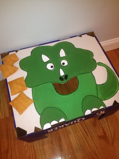 DIY Dino beanbag toss - but bean bags in the shape of tree stars