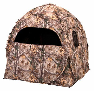 Evolved Ingenuity 1RX2S010 Hunting Doghouse Ground Blind, Camo Pattern, 60 x 60 x 66-In.   https://huntinggearsuperstore.com/product/evolved-ingenuity-1rx2s010-hunting-doghouse-ground-blind-camo-pattern-60-x-60-x-66-in/