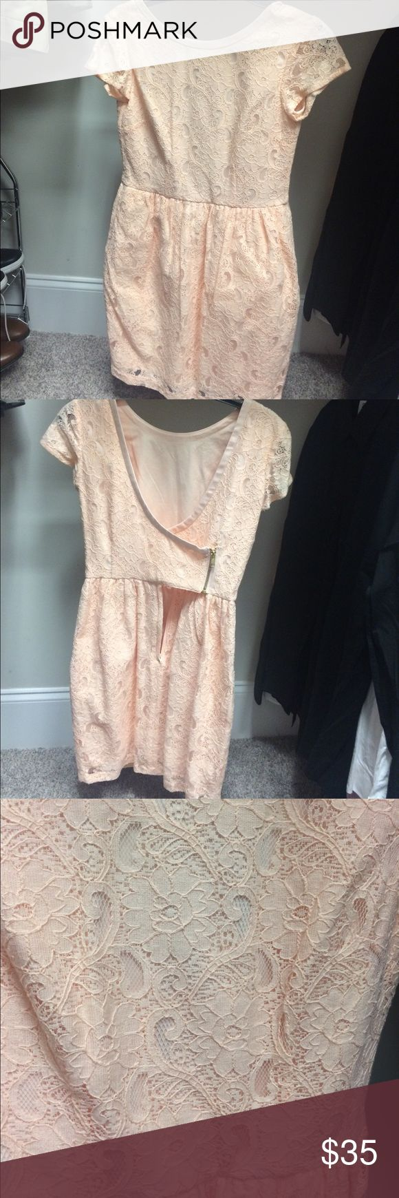 Peach Lace dress Peach lace mini dress...very dainty & girly-girl. Fitted around waste, low dip back, fitted on hips. H&M Dresses Mini