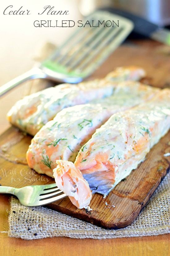 Amazing Cedar Plank Salmon smothered in creamy lemon dill sauce for you to grill this summer! | willcookforsmiles.com