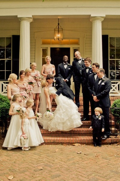 Front door of the church with bridesmaids and groomsmen
