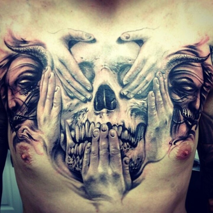 realistic greyscale full chest plate tattoo of skull, hands, and faces