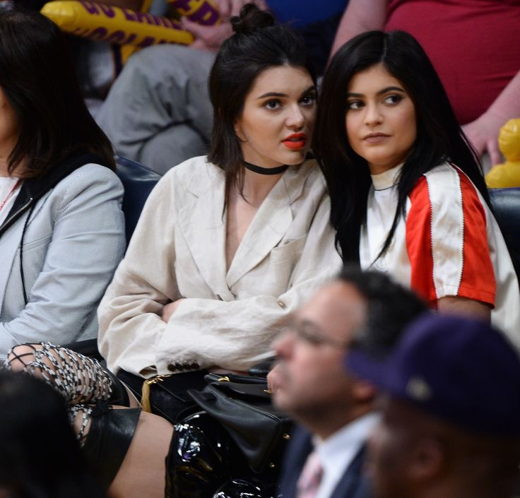 Kendall and Kylie Jenner Twin in Thigh-High Boots at Lakers Game