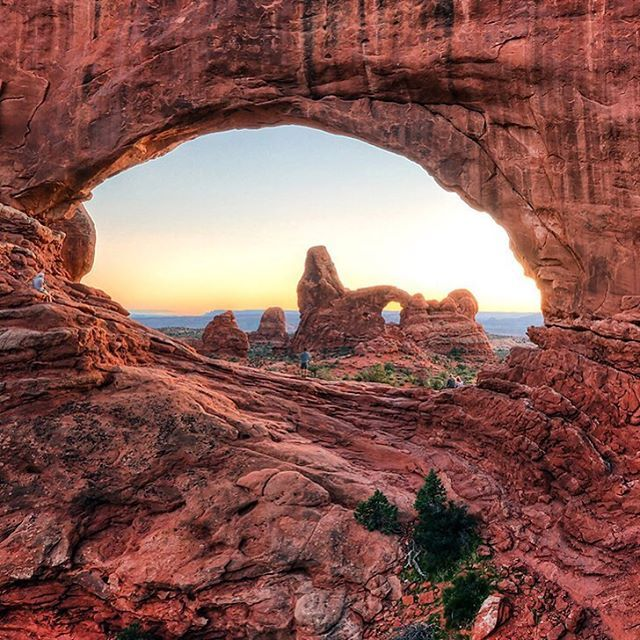 Visit Utah's Arches National Park and discover a landscape unlike any other in the world. The park is home to natural stone arches, soaring pinnacles and epic views like this one of Turret Arch as seen through North Window. If you look closely, you'll see a few people enjoying the view. Photo  courtesy of William Rainey.
