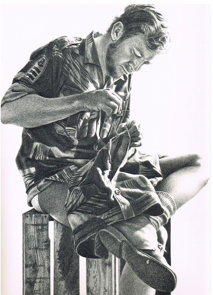 Portrait of a Vedette Section Leader doing field repairs on his uniform.