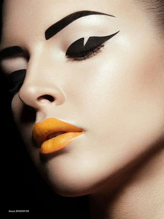 Taking a wedge out of a thick liner look, paired with bold lips makes for a striking and interesting eyeliner makeup.