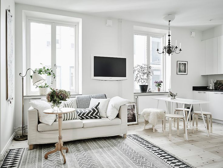 White Apartment scandinavian studio apartment with bright white interiors | the