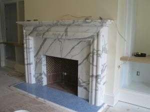 marble fireplace could be calacatta oro white venatino or statuary white