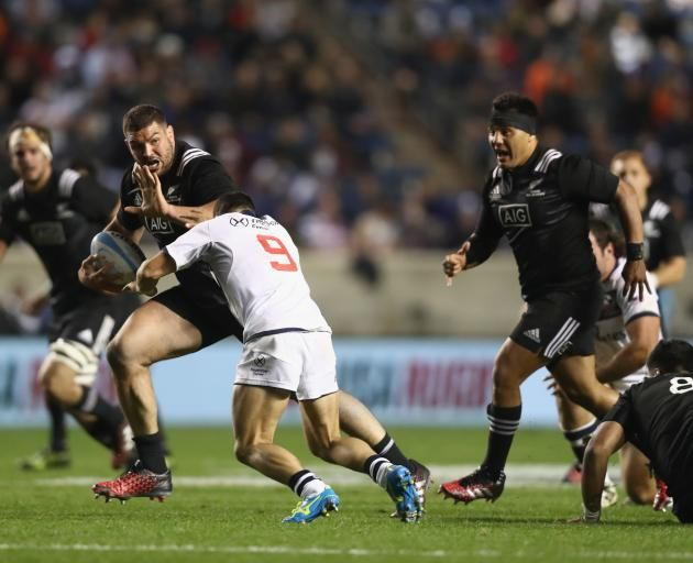 Ben May of the Maori All Blacks fends off a tackle from a US Eagles player at Toyota Park in...